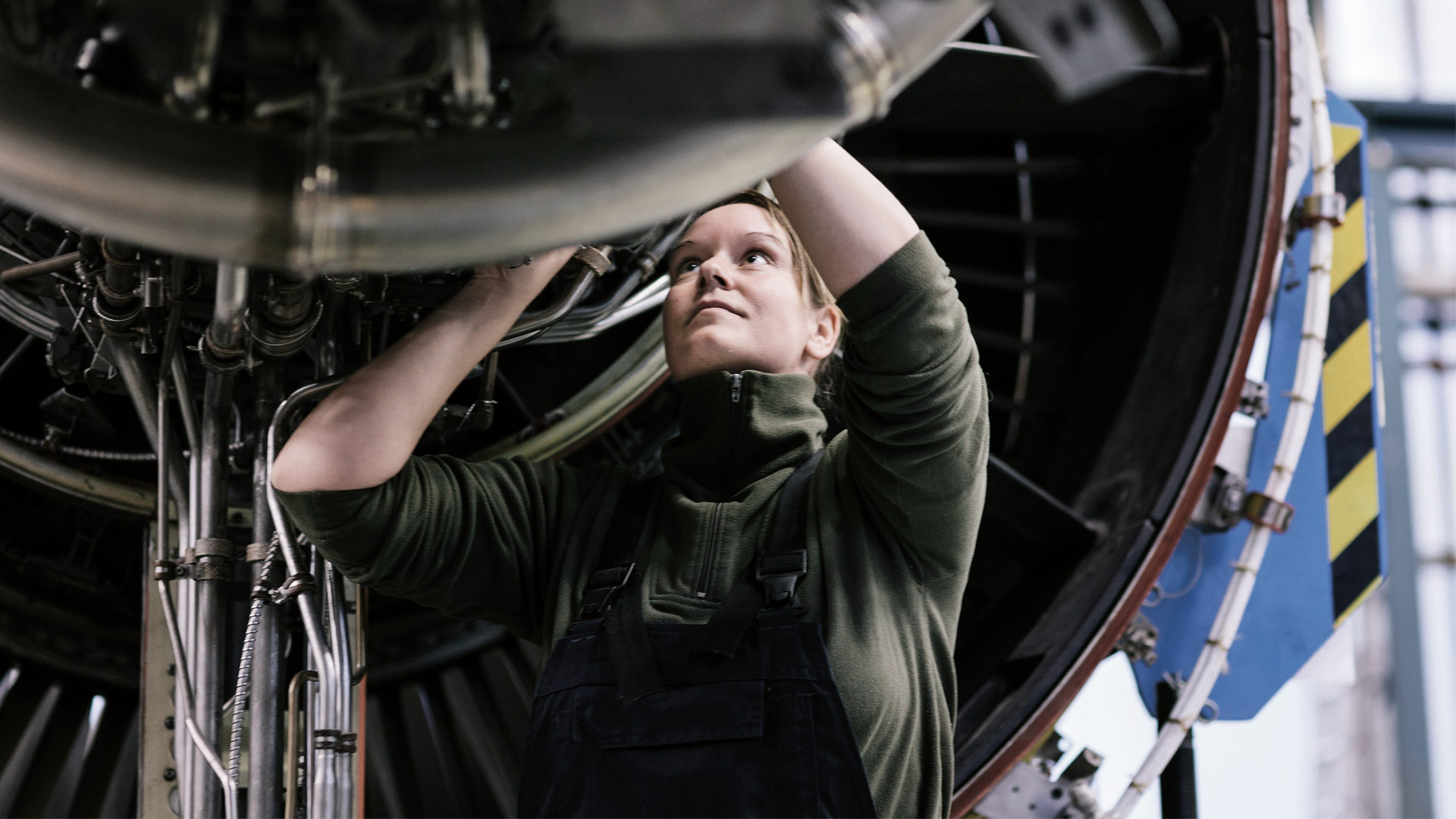 Woman working on an engine